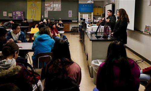 Camacho and Mejia talk to students at Grandview High School.