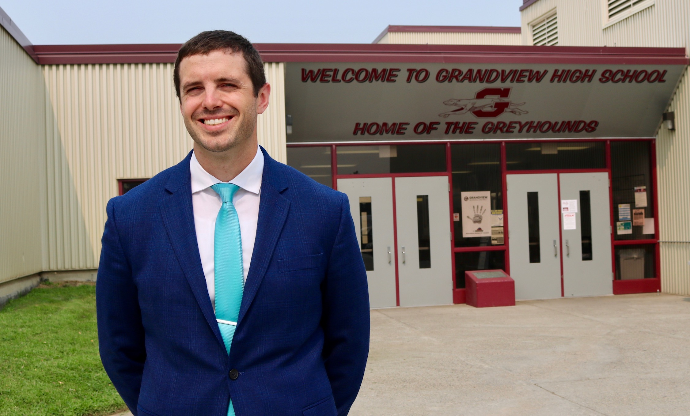 Assistant Principal Kurtis Reser stands in front of GHS.