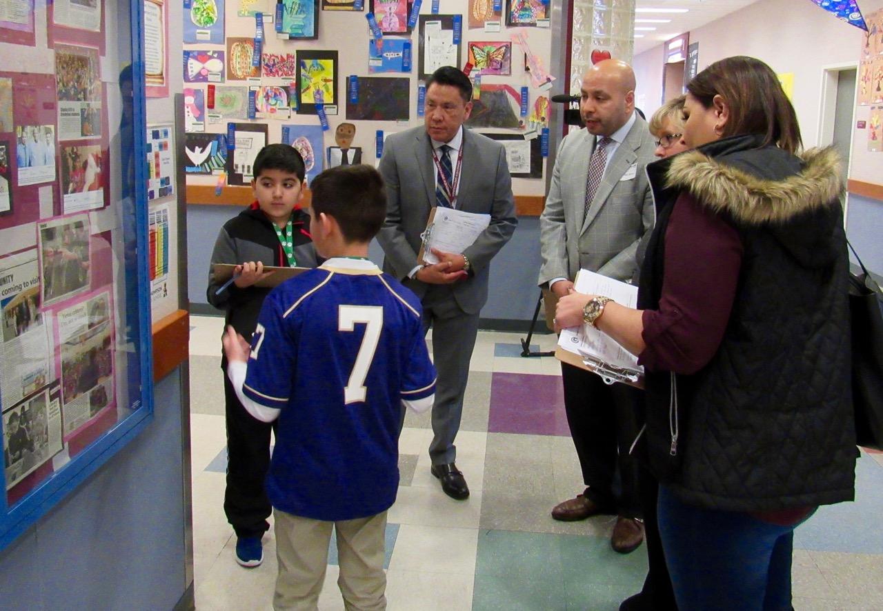 Fifth grade student leaders walk administrators and community members through HT.